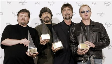 "Members of the country band ""Alabama"" pose with their Award of Merit at the 30th annual American Mus.."