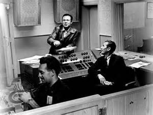 Jim Reeves (center) recording with Chet Atkins (right)