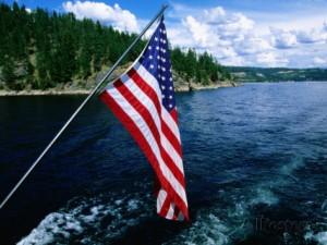 holger-leue-american-flag-on-boat-lake-coeur-d-alene-coeur-d-alene-idaho